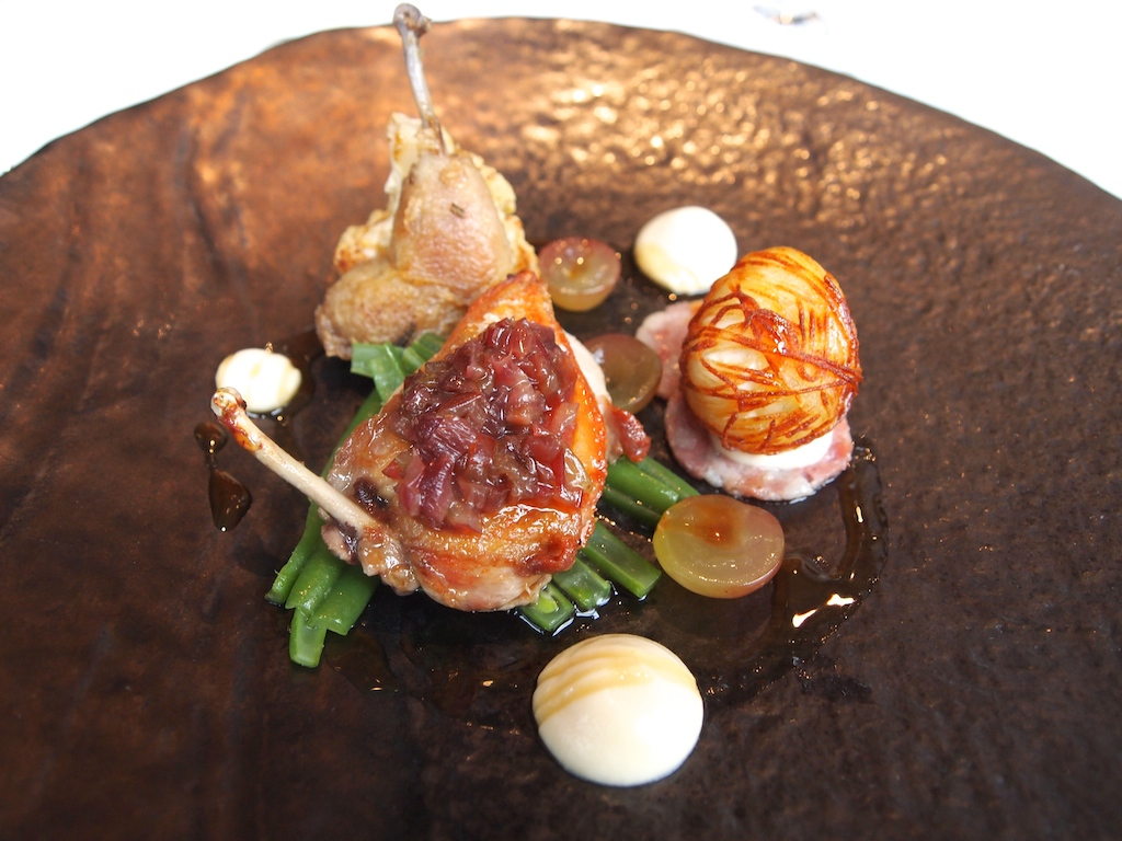 ... breast and confit leg), braised shallots, quail's egg wrapped in crisp